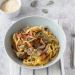 Spaghetti con speck e carciofi